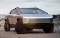Tesla Cybertruck Electric Pickup Truck Front 3 4 View With Off Road Lights And Headlights Illuminated