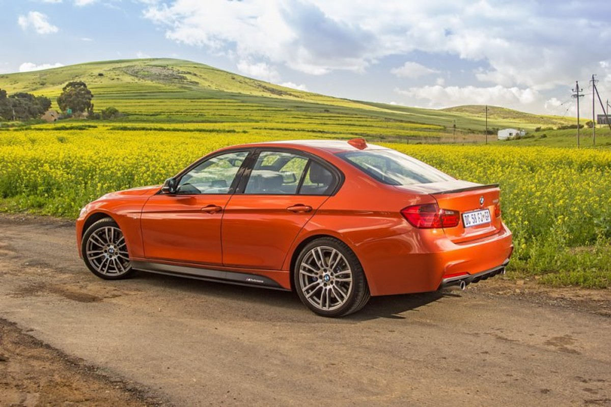 1e5a12068ef The BMW 335i M Performance Edition garners loads of attention from  onlookers. Here in its Valencia Orange hue with carbon fibre accessories it  makes a ...